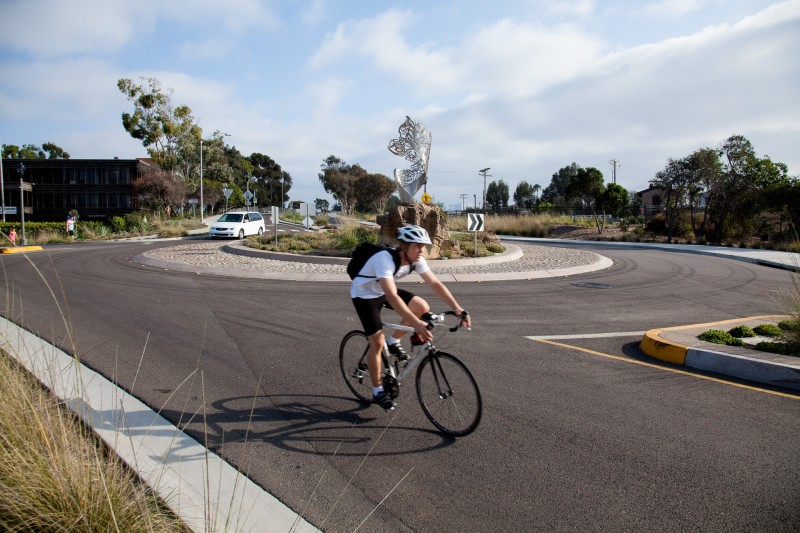 Cyclist riding in roundabout in Carlsbad, California