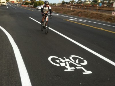 Cyclist riding in bike lane in Encinitas, California