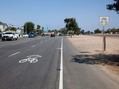 "Sharrow and ""Bicycles May Use Full Lane"" sign on highway 101 in Leucadia, California"