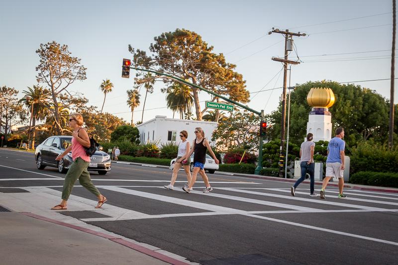 People walking in HAWK crosswalk in Encinitas, California